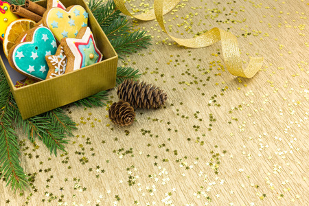 gingerbread cookies: christmas decorations with gingerbread cookies, fir branches and gold ribbon
