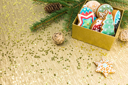 gingerbread cookies: christmas gift box with colorful gingerbread cookies on golden background