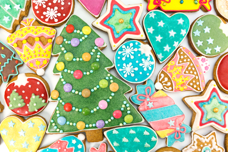sugar: homemade various decorated christmas gingerbread cookies on white background, top view