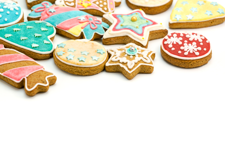 gingerbread cookie: homemade colorful decorated christmas gingerbread cookies on white background