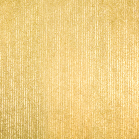 textured paper: textured striped packaging recycled golden paper for background Stock Photo