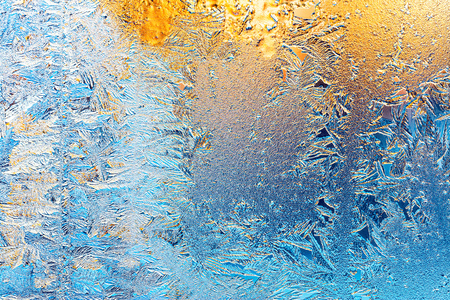 frost and sun on winter window glass Stock Photo