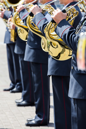 brass  band: military musicians playing on french horns in army brass band Stock Photo