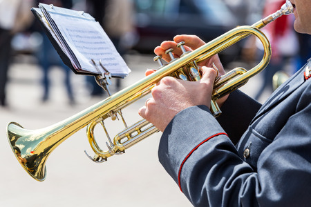 trumpet: military musician playing on gold trumpet in army brass band