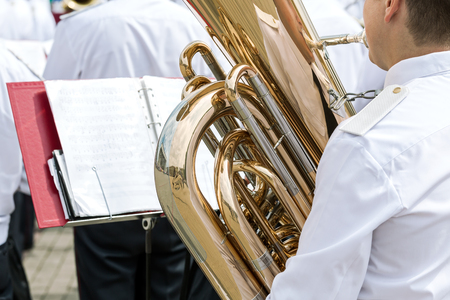 tuba: musician are playing a big bass tuba in military band