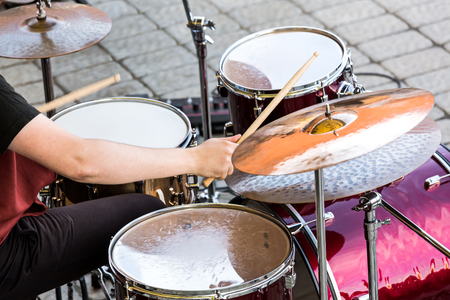 cymbals: drummer playing at drums set and cymbals on street concert