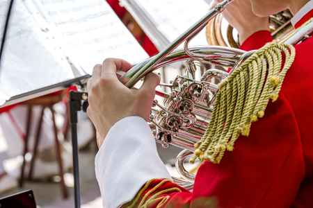 french horn: musician playing french horn during a classical concert music