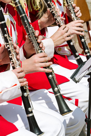 clarinet: young musician performs with clarinet in an street orchestra Foto de archivo