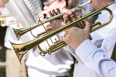 brass: military brass band musicians with gold trumpets