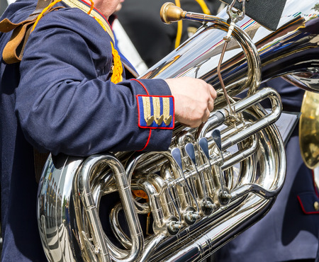 tuba: musician playing on big bass tuba in street orchestra Stock Photo
