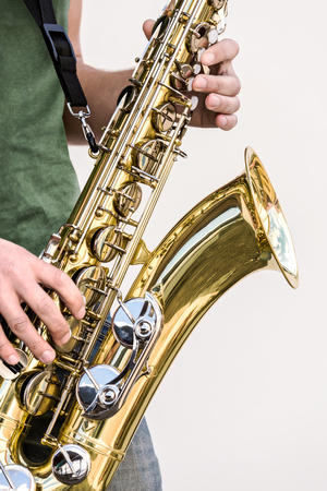 tenor: men playing brass tenor saxophone during a live performance