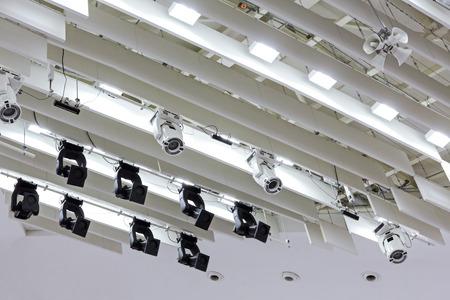 professional studio lighting equipment on theater stage lighting rig Stock Photo