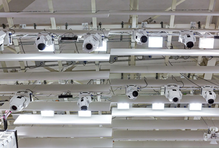 lighting equipment: professional lighting equipment near ceiling of theater stage