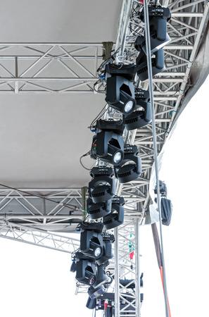 outdoor lighting: lighting rig with spotlights under roof of outdoor stage
