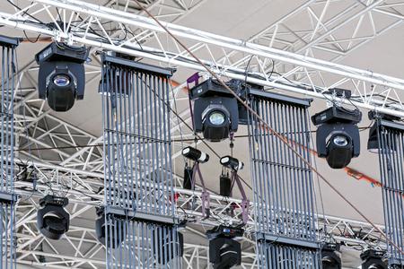 outdoor lighting: professional lighting equipment under roof of outdoor concert stage