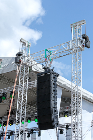 stage lighting: stage lighting and sound equipment on outdoor stage before concert Stock Photo