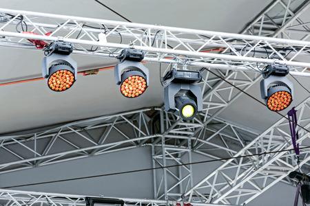 outdoor lighting: professional lighting equipment under roof of outdoor stage