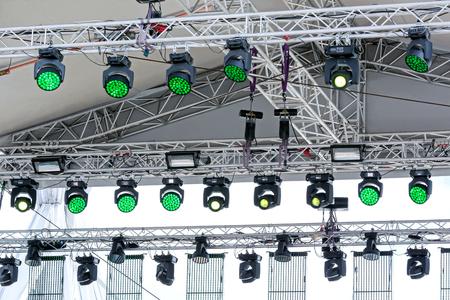 outdoor lighting: lighting equipment under roof of outdoor concert stage