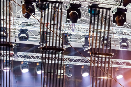 halogen lighting: stage lights near ceiling of outdoor concert stage Stock Photo