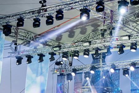 studio lighting equipment high above an outdoor stage