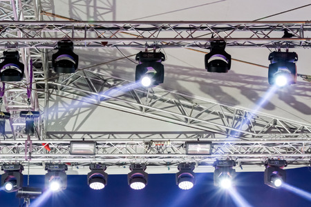 lighting equipment: lighting equipment high above an outdoor concert stage Stock Photo