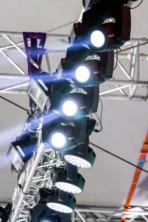 outdoor lighting: multiple spotlights on outdoor concert stage lighting rig