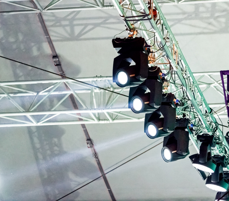 outdoor lighting: many spotlights on outdoor concert stage lighting rig