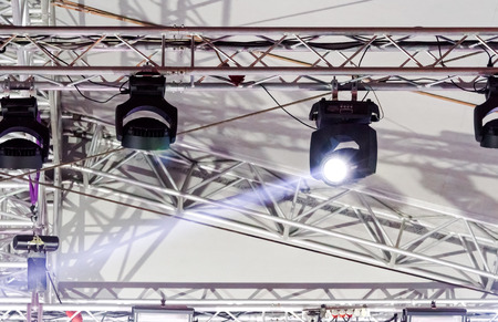 lighting equipment high above an outdoor concert stage Stock Photo