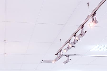 halogen: row of bright halogen spotlights on exhibition ceiling