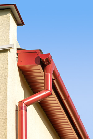 overhang: new rain gutter system on a corner of home