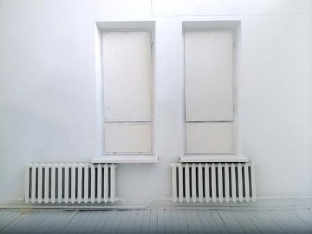 interior: Empty interior room with two closed windows