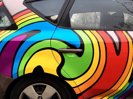 artistic: Abstract striped colorful rainbow painting on custom vehicle Stock Photo
