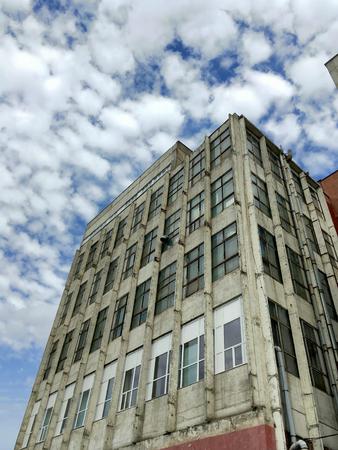 abandoned warehouse: abandoned industrial warehouse under dramatic sky