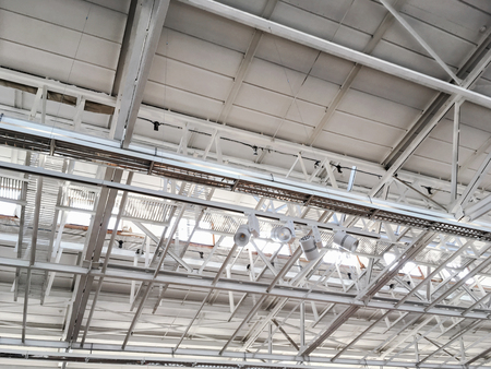 building structure: metal roof structure of modern industrial building background Stock Photo