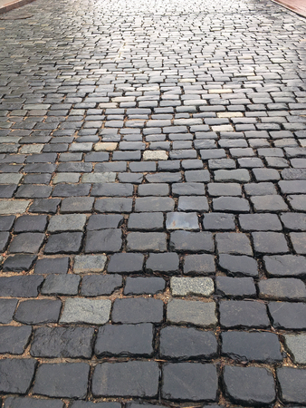 cobblestone road: old wet granite cobblestone road as texture background