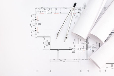 compas de dibujo: rolls of architectural blueprints and technical drawings with drawing compass Foto de archivo