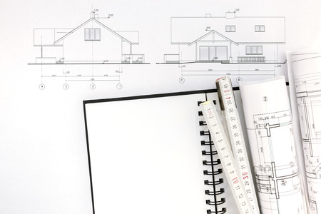 house blueprints: architects workspace with house blueprints, notepad and ruler