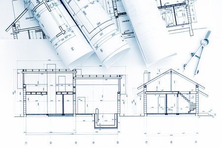 compas de dibujo: home plans and blueprint rolls with drawing compass on desk