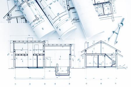 compas de dibujo: planos de casas y rollos de plano con Compás de dibujo en el escritorio