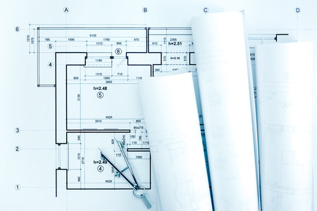 compas de dibujo: architectural blueprint rolls and plans with drawing compass on desk