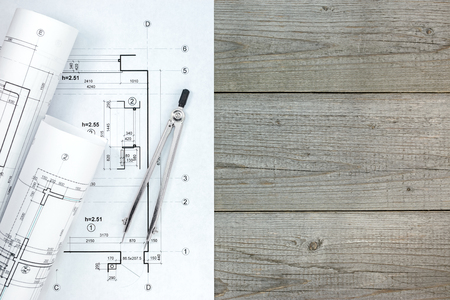 compas de dibujo: architect workspace with plan, rolls of blueprints and drawing compass