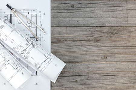 compas de dibujo: architect workspace with floor plan and drawing compass on gray desk