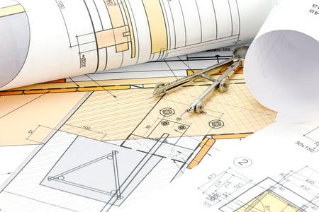 compas de dibujo: architects workspace with blueprint, rolls and drawing compass Foto de archivo