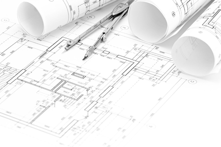 compas de dibujo: rolls of architectural blueprints and floor plan with drawing compass