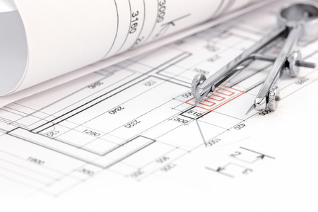 compas de dibujo: floor plan background with blueprint roll and drawing compass