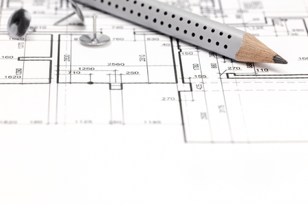 floor plan: architectural background with floor plan drawing and pencil Stock Photo