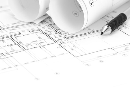floor plan: architect workspace with floor plan, blueprint roll and pencil