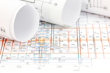 floor plan: technical drawing detail and rolls of floor plan blueprints Stock Photo