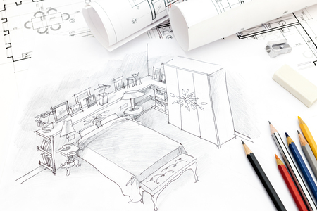 paper rolls: bedroom interior hand drawing with blueprint, paper rolls and pencils