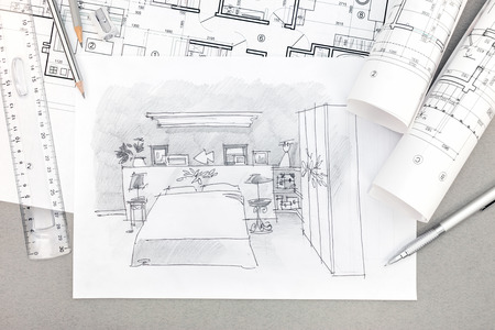drawing a plan: hand-drawn illustration of bedroom interior with drawing tools and blueprints on desk